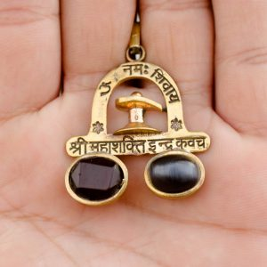 The Mahashakti Indra Kavach locket held on the hand is shown in this image