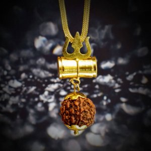 A square Mahakal Kavach locket with angles hanging in front of a black stone as shown in this image