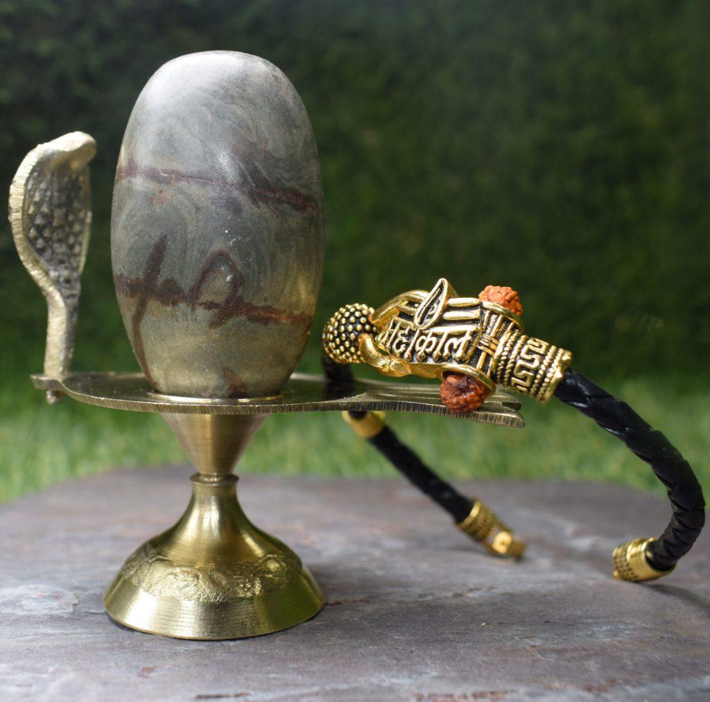 Narmadeshwar Shivling with Pure Brass Base and Mahakal Leather Bracelet